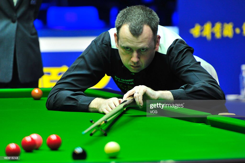 Mark Williams of Wales plays a shot during the match against Marco Fu of Hong Kong on day three of the 2013 World Snooker Haikou Open at Haikou Convention and Exhibition Center on February 27, 2013 in Haikou, China.