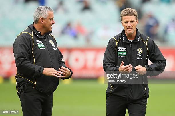 Mark Williams the assistant coach and Damien Hardwick the coach of the Tigers discuss tactics during the round seven AFL match between the Geelong...