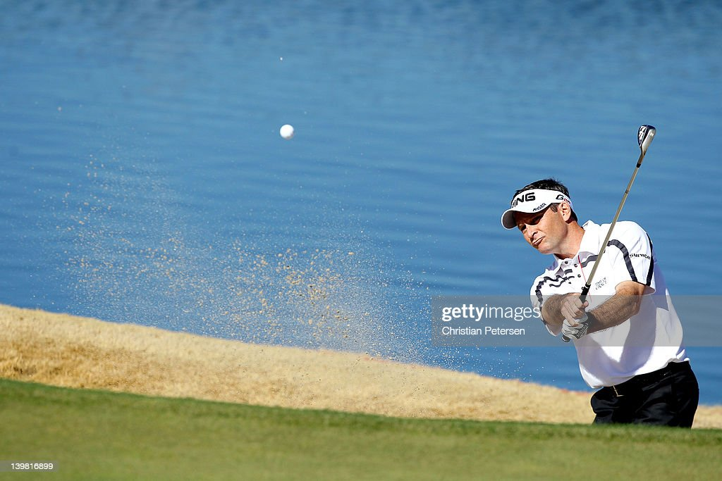 Mark Wilson hits from a bunker on the third hole during the quarterfinal round of the World Golf ChampionshipsAccenture Match Play Championship at...