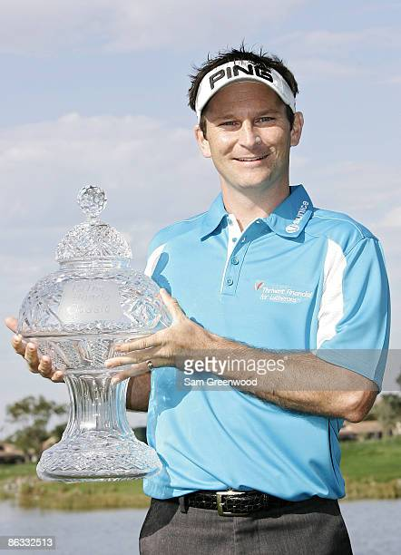 Mark Wilson holds the trophy after winning the Honda Classic on the Champion Course at PGA National in Palm Beach Gardens Florida on Monday March 5...