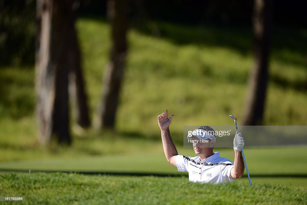 Mark Wilson holes out from the bunker to save par on the seventh hole during the second round of the Northern Trust Open at the Riviera Country Club on February 15, 2013 in Pacific Palisades, California.