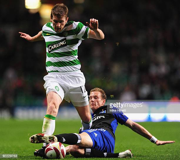Mark Wilson of Celtic is tackled by Marcell Jansen of Hamburger SV during the UEFA Europa League Group C match between Celtic and Hamburger SV at...