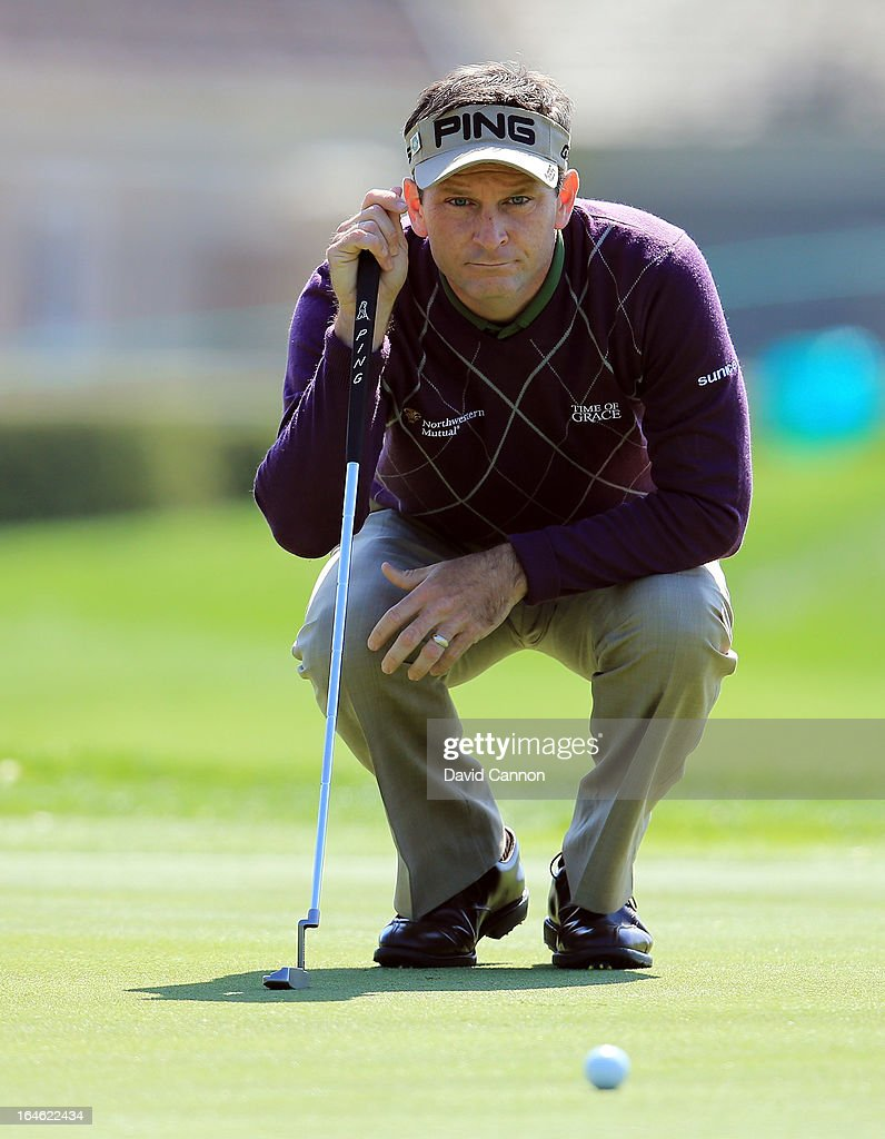Mark Wilson of the United States lines up a putt at the par 5, 12th hole during the final round of the 2013 Arnold Palmer Invitational Presented by Mastercard at Bay Hill Golf and Country Club on March 25, 2013 in Orlando, Florida.