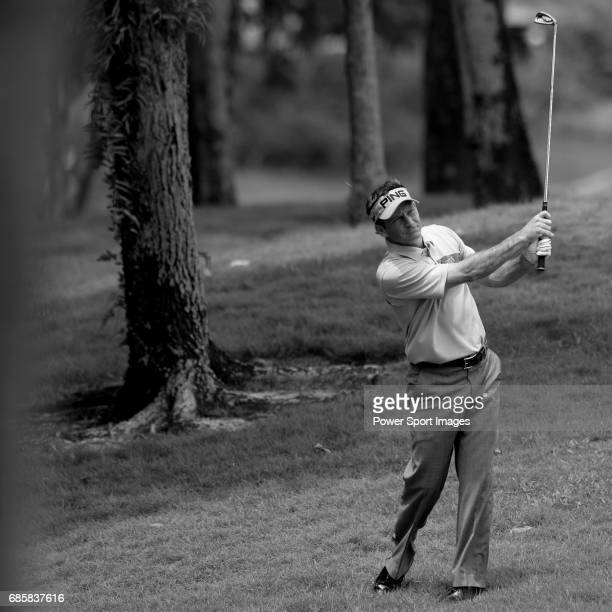 Mark Wilson plays a difficult second shot from the treelaiden rough on hole four during the CIMB Asia Pacific Classic 2011 at the MINES resort and...