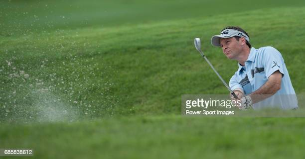Mark Wilson plays out of a bunker at the thirteenth green during the CIMB Asia Pacific Classic 2011 at the MINES resort and golf club on 29 October...
