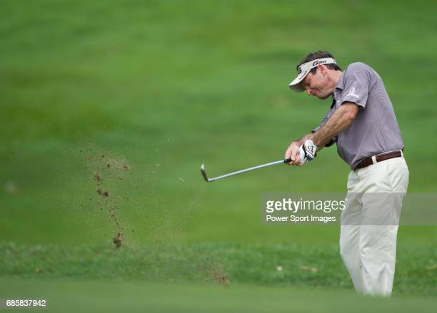 Mark Wilson takes his second shot on the eighth fairway during Round 2 of the CIMB Asia Pacific Classic 2011 at the MINES resort and golf club on 28...