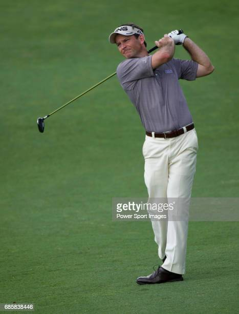 Mark Wilson takes his second shot on the seventeenth fairway during Round 2 of the CIMB Asia Pacific Classic 2011 at the MINES resort and golf club...