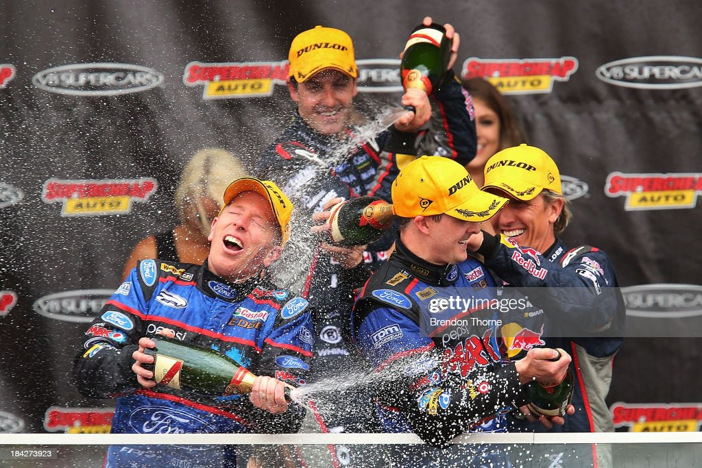 <a gi-track='captionPersonalityLinkClicked' href=/galleries/search?phrase=Mark+Winterbottom&family=editorial&specificpeople=675314 ng-click='$event.stopPropagation()'>Mark Winterbottom</a> and Steve Richards drivers of the #5 Pepsi Max Crew FPR Ford celebrate with champagne after winning the Bathurst 1000, which is round 11 of the V8 Supercars Championship Series at Mount Panorama on October 13, 2013 in Bathurst, Australia.