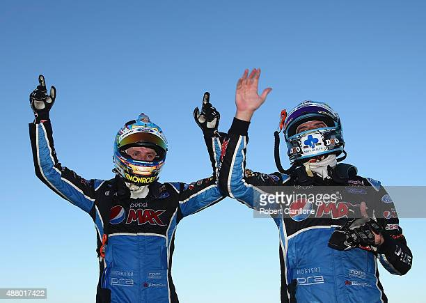 Mark Winterbottom driver of the Pepsi Max Crew Ford and teammate Chaz Mostert driver of the Pepsi Max Crew Ford celebrate after finishing first and...