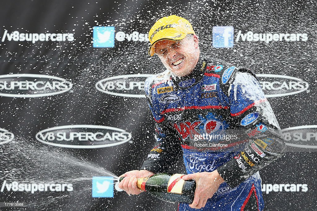 Mark Winterbottom driver of the Pepsi Max Crew FPR Ford celebrates after winning Race 26 of the V8 Supercar Championship Series at Winton Motor...