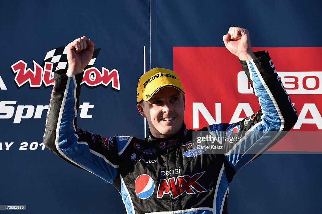 Mark Winterbottom driver of the Prodrive Racing Australia Ford FG X Falcon celebrates on the podium after winning Race 3 for the V8 Supercars Winton...