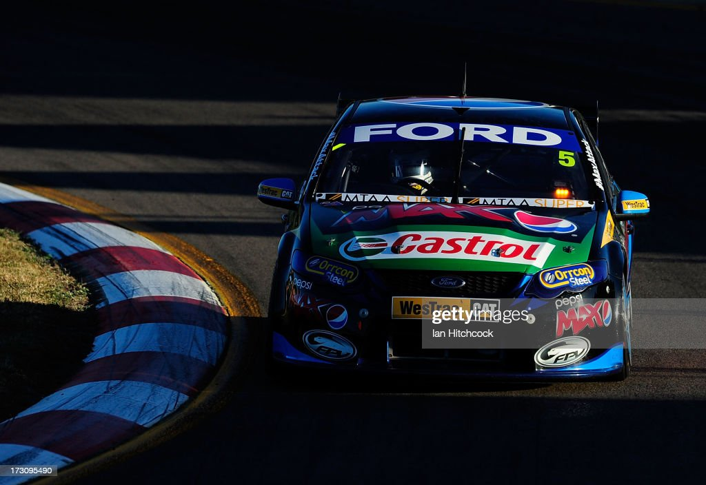 <a gi-track='captionPersonalityLinkClicked' href=/galleries/search?phrase=Mark+Winterbottom&family=editorial&specificpeople=675314 ng-click='$event.stopPropagation()'>Mark Winterbottom</a> drives the #5 Ford's Pepsi Max Crew Ford during race 21 of the Townsville 400, which is round seven of the V8 Supercar Championship Series at Reid Park on July 7, 2013 in Townsville, Australia.