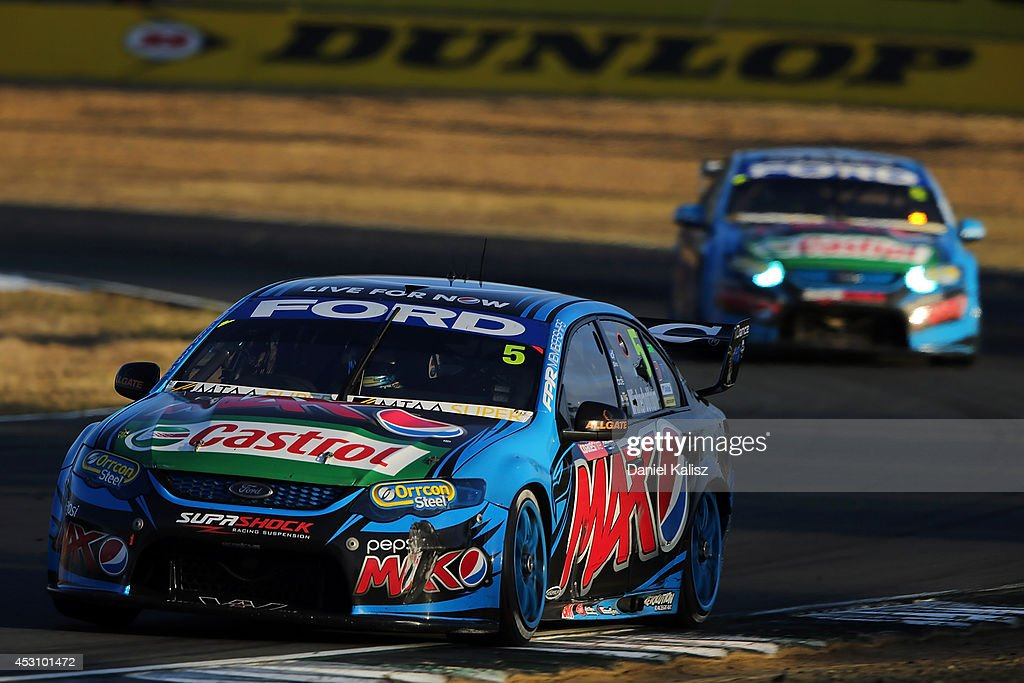 <a gi-track='captionPersonalityLinkClicked' href=/galleries/search?phrase=Mark+Winterbottom&family=editorial&specificpeople=675314 ng-click='$event.stopPropagation()'>Mark Winterbottom</a> drives the #5 Pepsi max Crew Ford during race 25 for the Ipswich 400, which is round eight of the V8 Supercar Championship Series at Queensland Raceway on August 3, 2014 in Ipswich, Australia.
