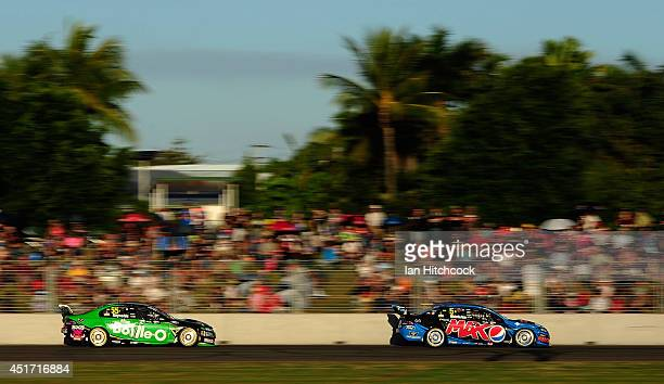 Mark Winterbottom drives the Pepsi Max Crew Ford in front of David Reynolds The BottleO racing Team Ford during race 21 for the Townsville 500 which...