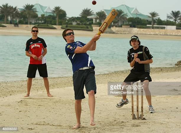 Mark Winterbottom of Ford Performance Racing plays a shot during a game of beach cricket ahead of preparations for the Bahrain Desert 400 which is...