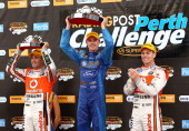 Mark Winterbottom of the Orrcon Steel FPR Ford team celebrates with Jamie Whincup and Craig Lowndes after winning race one of the V8 Supercars at...
