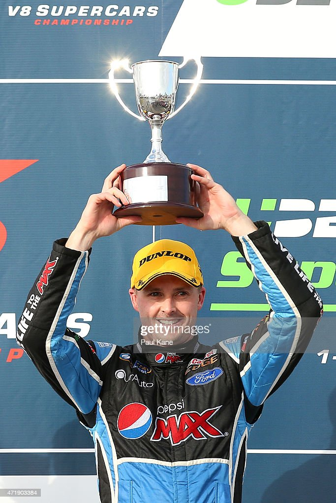 Mark Winterbottom of the Pepsi Max Crew team holds the trophy aloft after winning race 8 during the V8 Supercars Perth Supersprint at Barbagallo...