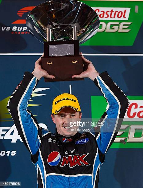 Mark Winterbottom who drives the Pepsi Max Crew Ford celebrates after winning race 17 of the Townsville 400 at Reid Park on July 12 2015 in...