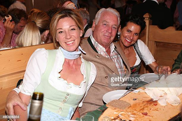 Mark Woessner and girlfriend Christiane Link and guest during the 'Sauerland Stammtisch' at Oktoberfest 2015 at Weinzelt /Theresienwiese on September...