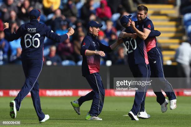 Mark Wood celebrates after capturing the wicket of Kane Williamson during the ICC Champions Trophy match between England and New Zealand at the...