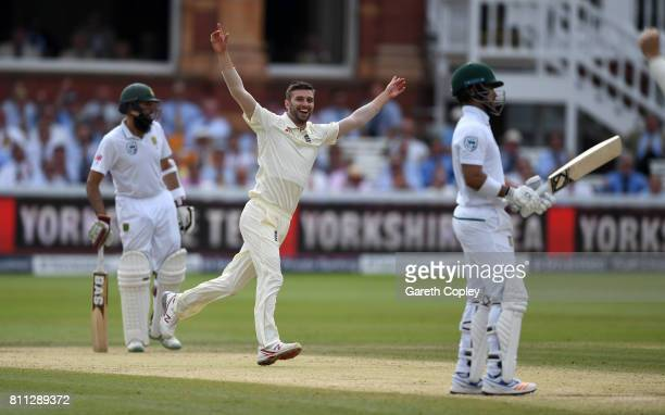 Mark Wood celebrates dismissing JeanPaul Duminy of South Africa during the 4th day of the 1st Investec Test between England and South Africa at...