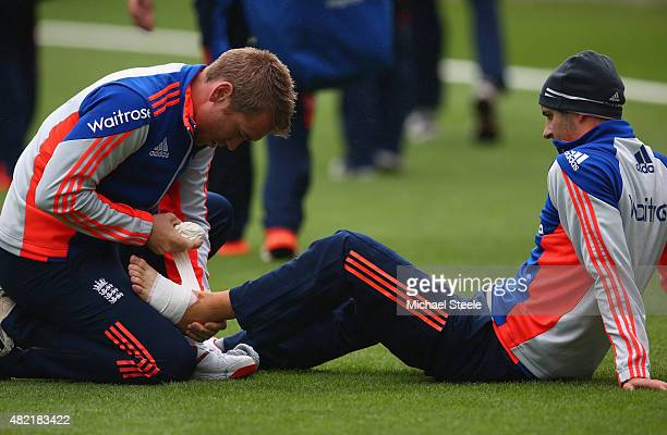 Mark Wood has strapping applied to his ankle by physio Craig de Weymarn during the England nets session ahead of the 3rd Investec Ashes Test match...