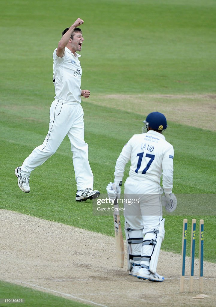 Mark Wood of Durham celebrates dismissing Ateeq Javid of Warwickshire during day two of the LV County Championship Division One match between Durham and Warwickshire at The Riverside on June 13, 2013 in Chester-le-Street, England.