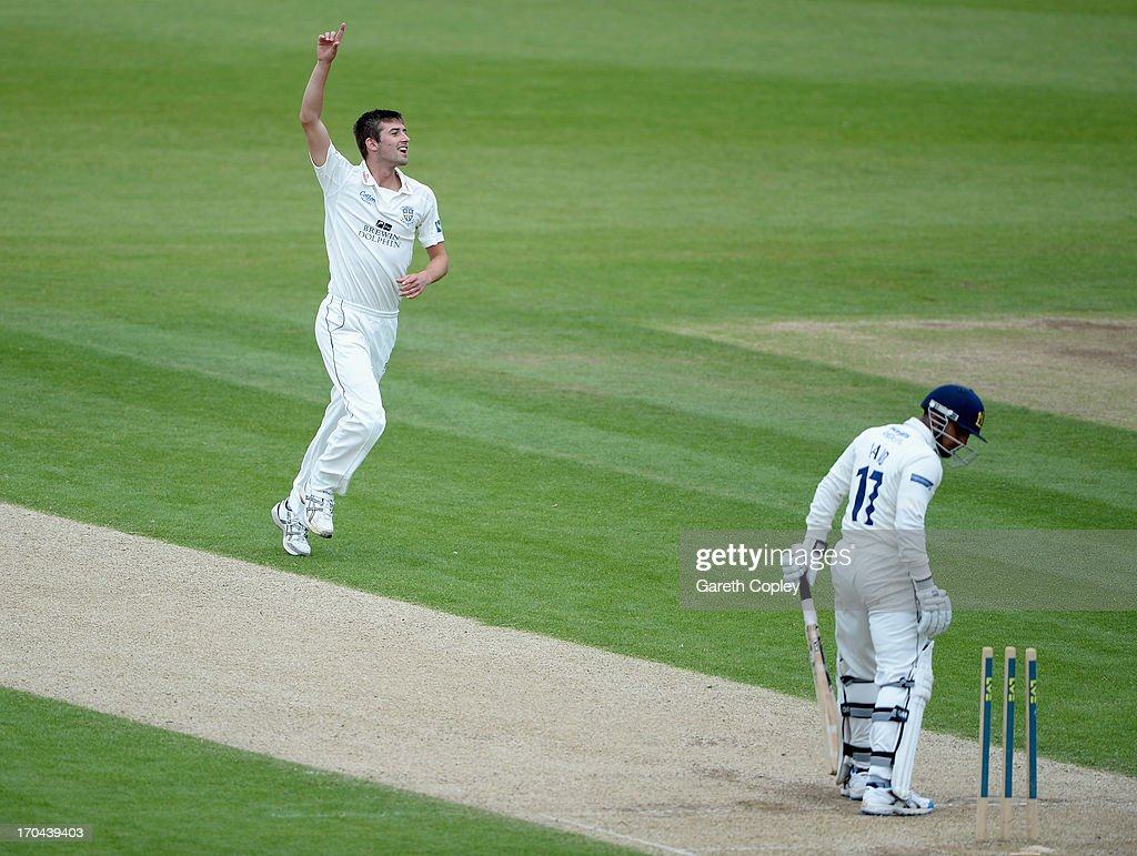 - JUNE 13: Mark Wood of Durham celebrates dismissing Ateeq Javid of Warwickshire during day two of the LV County Championship Division One match between Durham and Warwickshire at The Riverside on June 13, 2013 in Chester-le-Street, England.