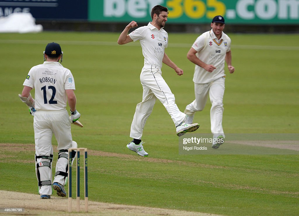 Mark Wood of Durham (C) celebrates taking the wicket of Sam Robson of Middlesex (L) during The LV County Championship match between Durham and Middlesex at The Riverside on June 2, 2014 in Chester-le-Street, England.