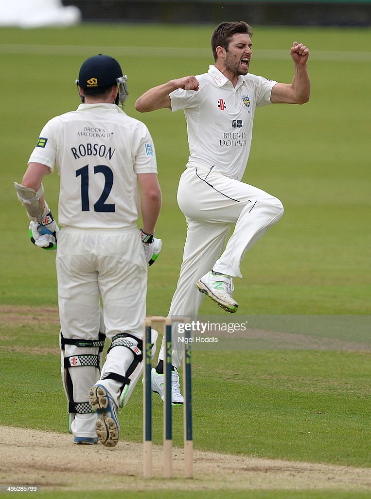 Mark Wood of Durham (R) celebrates taking the wicket of Sam Robson of Middlesex (L) during The LV County Championship match between Durham and Middlesex at The Riverside on June 2, 2014 in Chester-le-Street, England.