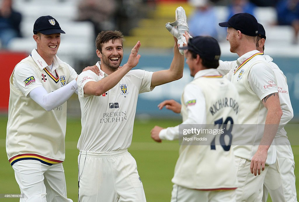 Mark Wood of Durham celebrates with teamates after taking the wicket of Dawid Malan during The LV County Championship match between Durham and...
