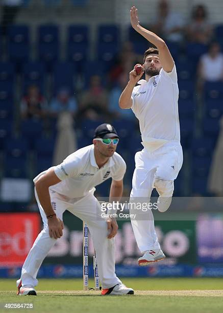 Mark Wood of England bowls alongside James Anderson during day two of the 1st Test between Pakistan and England at Zayed Cricket Stadium on October...
