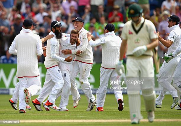 Mark Wood of England celebrates after taking the wicket of Adam Voges of Australia during day four of the 1st Investec Ashes Test match between...