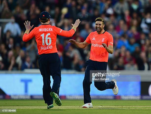 Mark Wood of England celebrates captain Eoin Morgan after taking a wicket during the NatWest International Twenty20 match between England and New...