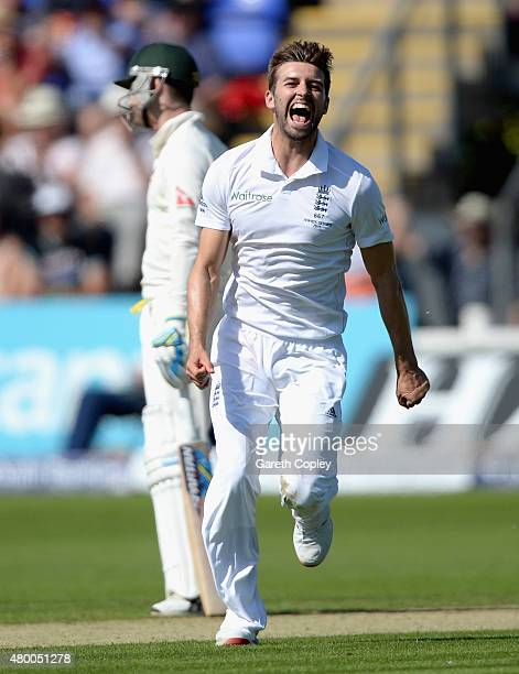 Mark Wood of England celebrates dismissing Chris Rogers of Australia during day two of the 1st Investec Ashes Test match between England and...