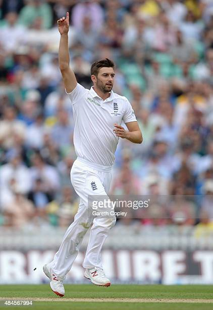 Mark Wood of England celebrates dismissing Chris Rogers of Australia during day one of the 5th Investec Ashes Test match between England and...