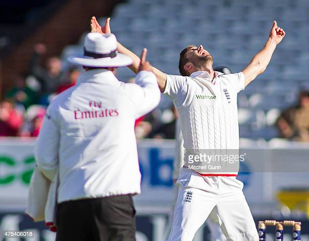 Mark Wood of England celebrates taking the wicket of Brendon McCullum as umpire Sundaram Ravi raises his finger during day three of the England v New...