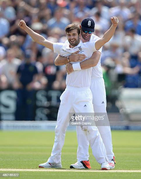 Mark Wood of England celebrates with James Anderson after dismissing Nathan Lyon of Australia during day three of the 1st Investec Ashes Test match...