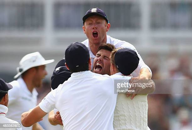 Mark Wood of England celebrates with Jonny Bairstow of England after taking the wicket of Nathan Lyon of Australia to reclaim the Ashes during day...