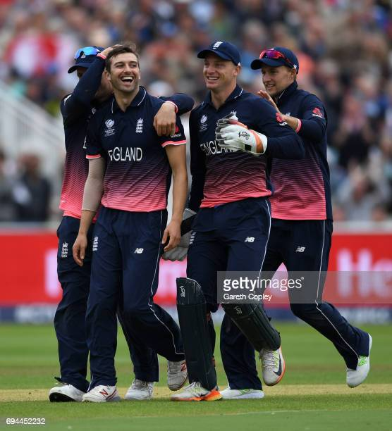 Mark Wood of England celebrates with teammates after dismissing Australian captain Steve Smith during the ICC Champions Trophy match between England...