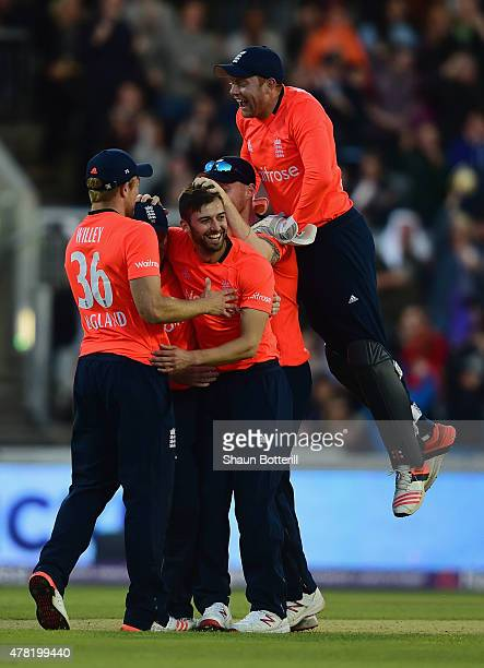 Mark Wood of England celebrates with teammates after taking a wicket during the NatWest International Twenty20 match between England and New Zealand...