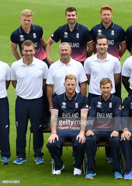 Mark Wood of England gives Sam Billings a shove as the team pose for their team photograph at The Kia Oval on May 31 2017 in London England