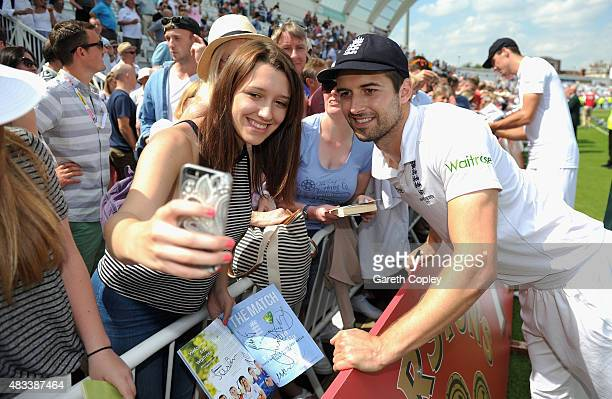 Mark Wood of England poses for a seflie with a fan after winning the 4th Investec Ashes Test match between England and Australia at Trent Bridge on...