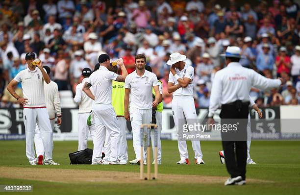 Mark Wood of England reacts after his delivery that claimed the wicket of Chris Rogers of Australia was called a no ball during day two of the 4th...