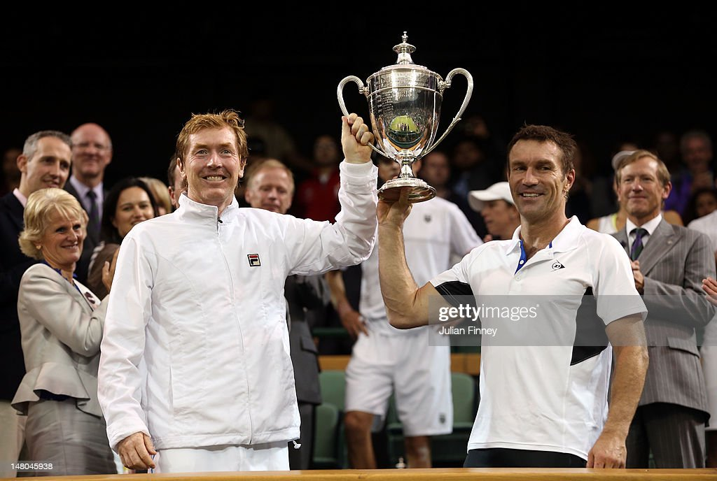 Mark Woodforde and Pat Cash of Australia hold up the winner's trophy after winning their Senior Men's Invitational Doubles final against Jeremy Bates of Great Britain and Anders Jarryd of Sweden on day thirteen of the Wimbledon Lawn Tennis Championships at the All England Lawn Tennis and Croquet Club on July 8, 2012 in London, England.