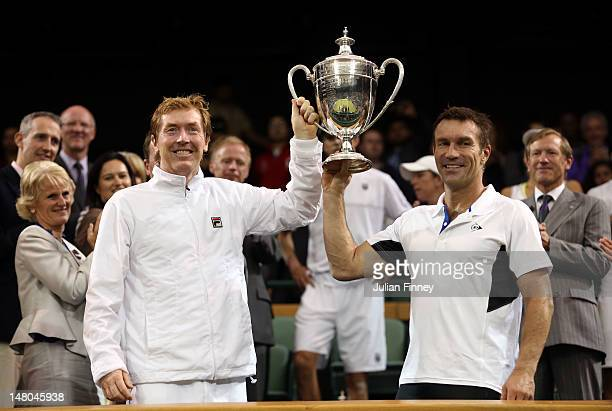 Mark Woodforde and Pat Cash of Australia hold up the winner's trophy after winning their Senior Men's Invitational Doubles final against Jeremy Bates...