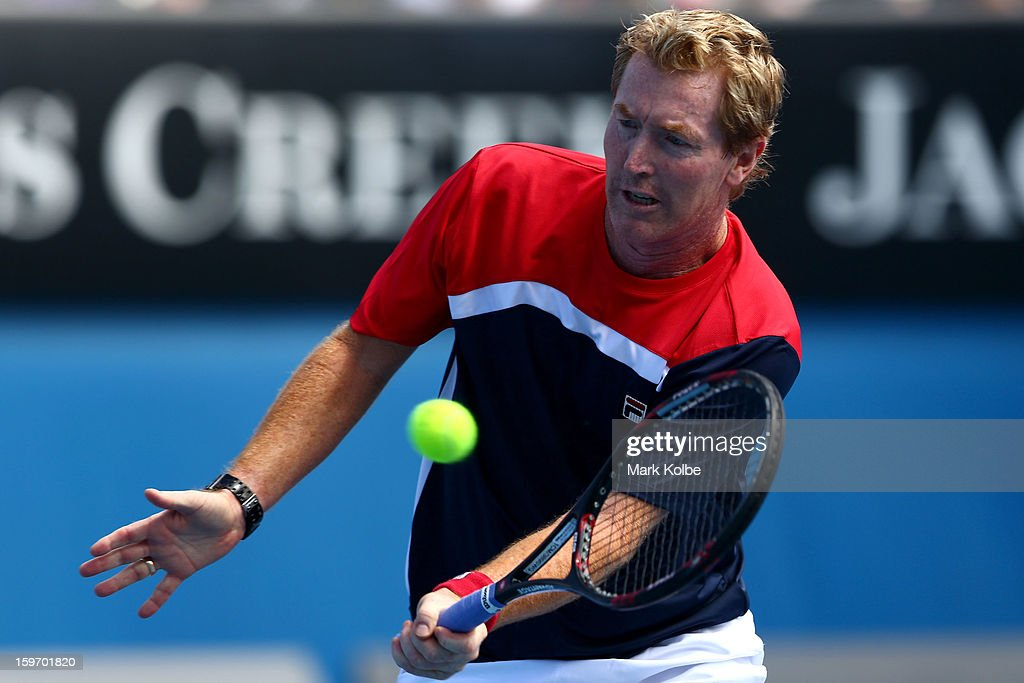 Mark Woodforde of Australia plays a forehand in his legends doubles round one match with Todd Woodbridge of Australia against Wayne Ferreira of South Africa and Mansour Bahrami of Iran during day six of the 2013 Australian Open at Melbourne Park on January 19, 2013 in Melbourne, Australia.