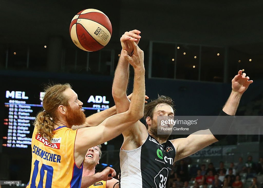 Mark Worthington of Melbourne United is challenged by Luke Schenscher of the Adelaide 36ers during the round eight NBL match between Melbourne United...