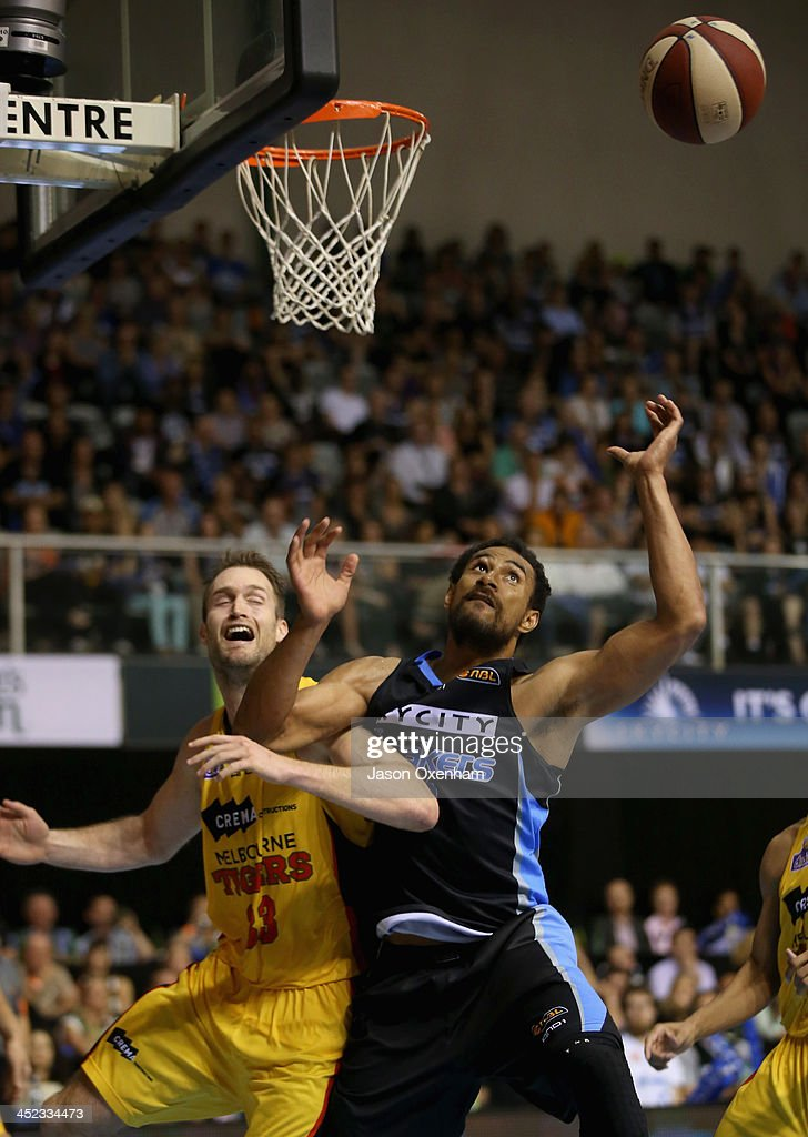 Mark Worthington of the Melbourne Tigers (L) and Mika Vukona of the Breakers battle for possession during the round eight NBL match between the New Zealand Breakers and the Melbourne Tigers at North Shore Events Centre on November 28, 2013 in Auckland, New Zealand.