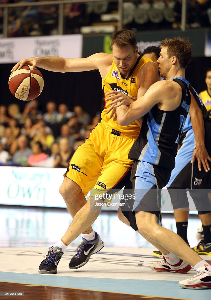 Mark Worthington of the Melbourne Tigers drives into Thomas Abercrombie of the Breakers during the round eight NBL match between the New Zealand Breakers and the Melbourne Tigers at North Shore Events Centre on November 28, 2013 in Auckland, New Zealand.